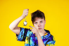 Affective teenage boy with watch showing time Royalty Free Stock Photography