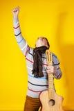Affektiver Teenager mit Gitarre Abbildung der elektrischen Gitarre Stockfoto
