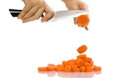 Affettare carota Fotografia Stock