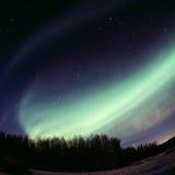 Affichage auroral intense - l'arc Image stock