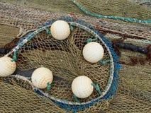Affichage jaune de filet de pêche et de flotteurs texturisé Photos libres de droits