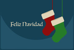 Affiche de Feliz Navidad avec des chaussettes de Noël Photo stock
