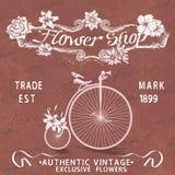Affiche de vintage pour la conception de fleuriste avec la vieille bicyclette Photographie stock