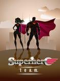 affiche Superheropaar: Mannetje en wijfje superheroes, binnen stellend Royalty-vrije Stock Foto
