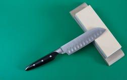 Affilage de couteau Photographie stock libre de droits