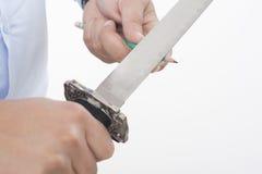 Affilatura delle matite con una spada Immagine Stock