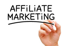 Affiliate Marketing. Hand writing Affiliate Marketing with black marker on transparent wipe board Stock Photo