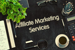 Affiliate Marketing Services Concept. 3D render. Top View of Office Desk with Stationery and Black Chalkboard with Business Concept - Affiliate Marketing Stock Photos