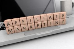 Affiliate Marketing text concept. Affiliate Marketing - wooden letters on notebook computer - 3d render illustration Royalty Free Stock Photography