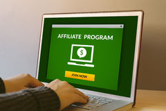 Affiliate program concept on laptop computer screen on wooden ta Royalty Free Stock Images