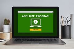 Affiliate program concept on laptop screen on modern desk. All screen content is designed by me. Front view Stock Image