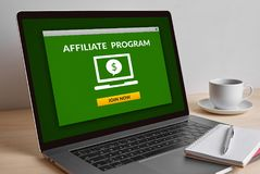 Affiliate program concept on modern laptop computer screen. On wooden table. All screen content is designed by me Royalty Free Stock Images
