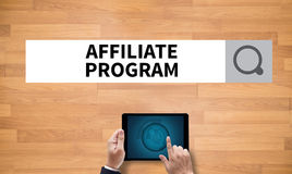 Affiliate Program. On the tablet pc screen held by businessman hands - online, top view Stock Image