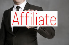 Affiliate signboard is held by businessman Royalty Free Stock Image