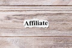 Affiliate of the word on paper. concept. Words of Affiliate on a wooden background.  Royalty Free Stock Photos