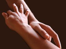 Affinity. Male and female hands caressing each other Royalty Free Stock Photography