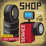 Affischen för tappninggummihjulservice med textgummihjulet shoppar och servar Arkivbild