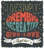 Affischen med levande text enkelt, dröm- stort, är idérik, ger förälskelse, det borttappade skrattet Royaltyfri Foto