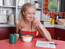 Affluent housewife having breakfast Stock Photos