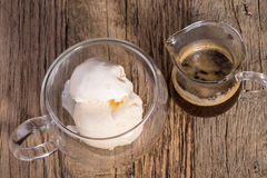 Affogato, espresso coffee and Vanilla ice cream in double walled glass italian dessert, on the rustic wooden table Royalty Free Stock Photos