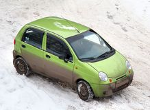 Affordable car. In a snowy parking stock photos