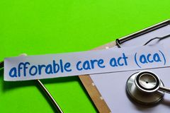 Affordable care act ACA on Healthcare concept with green background stock images