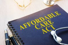 Affordable Care Act ACA on a table. Affordable Care Act ACA and stethoscope on a table stock images