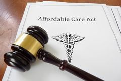 Affordable Care Act and judge`s gavel. Affordable Care Act aka ObamaCare document with a legal gavel Stock Photos
