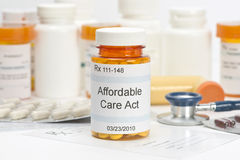 Affordable Care Act. Pill bottle with prescription and medical supplies. Labels and all information contained therein are fictitious royalty free stock images