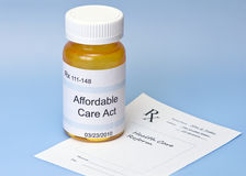 Affordable Care Act. Prescription bottle on blue with prescription for health care reform royalty free stock image