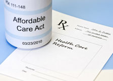 Affordable Care Act. Prescription bottle on blue with prescription for health care reform royalty free stock images