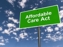 Affordable care act road sign. With blue sky and cloudscape background royalty free stock photography