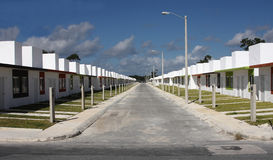 Affordable Homes in Mexico. Street of affordable houses in the new village of Villas Playa in Puerto Morelos, Mexico stock photo