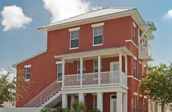 Affordable Housing. Red and white two-story affordable condominiums with white stairway and balconies stock image