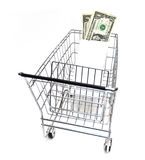 Affordable Shopping. Metal shopping cart with money on white background. American currency stock images