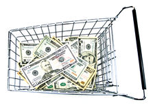 Affordable Shopping. Metal shopping cart with money on white background. American currency royalty free stock photography