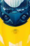 Affrontez le scooter jaune Photographie stock libre de droits
