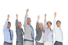 Affärsfolk som lyfter deras armar Arkivfoton