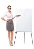 Affärskvinna med flipdiagrammet Arkivbilder