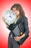 Affärskvinna med klockan Royaltyfria Bilder