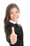 affärskvinna som ger upp tum Arkivbild