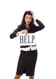 Affärskvinna som är bönfallande för hjälp Arkivfoto