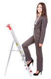 Affärskvinnaklättringstege Arkivbild