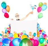 Affärsman med banret, ballonger och coctailen Arkivfoton
