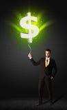 Affärsman med en ballong för dollartecken Arkivfoto