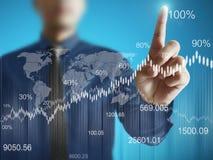 Affärsman med finansiella symboler Arkivbild