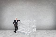 Affärsman nära den stora iskuben Fotografering för Bildbyråer