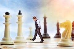 Affärsman på schackbrädet Royaltyfria Bilder