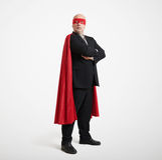 Affärsman som bär som toppen hjälte Arkivfoto