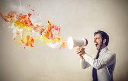 Affärsman som ropar från en megafon Arkivfoton